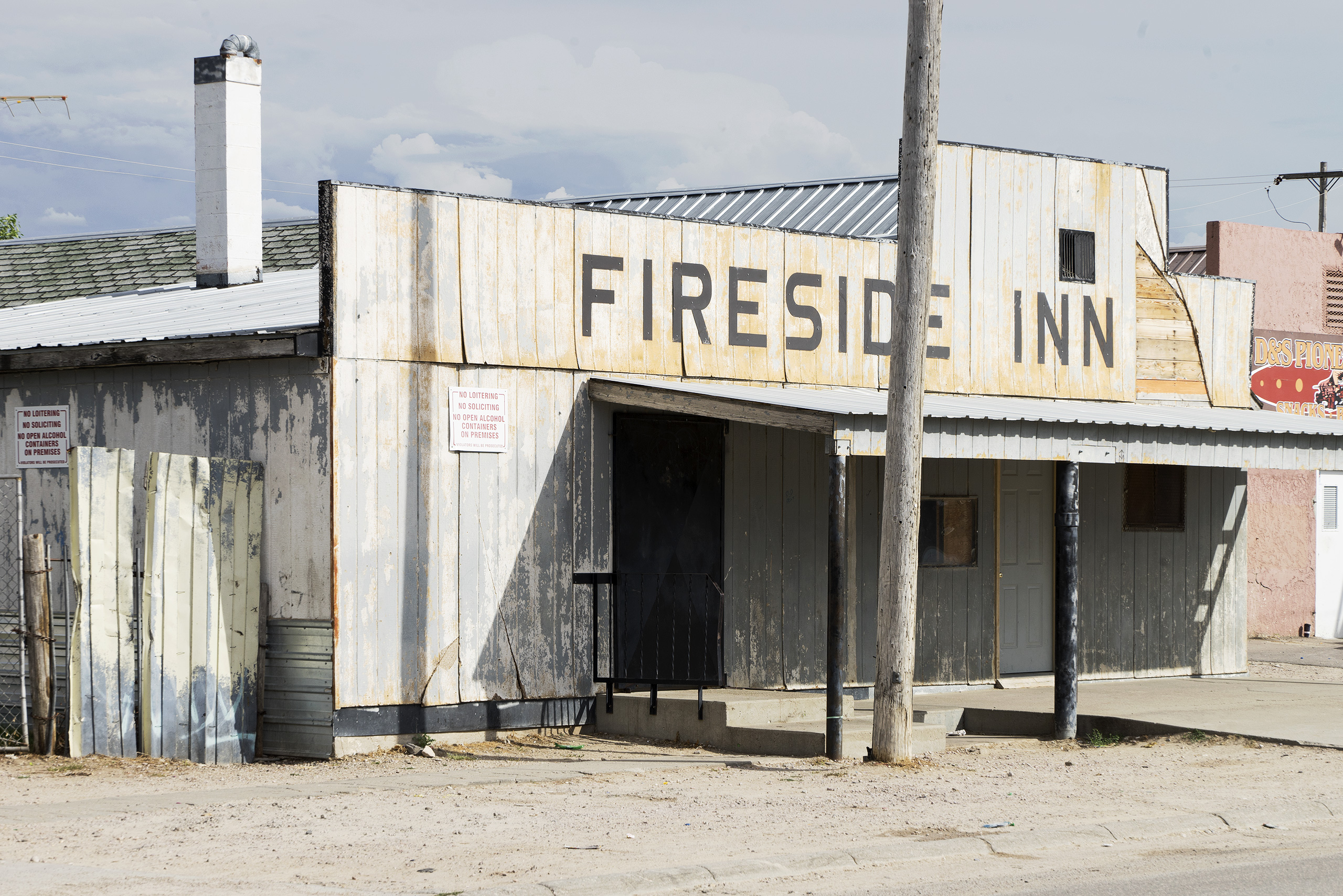 The Fireside Inn; Mission, SD  The Fireside Inn is one of the four bars and restaurants in Whiteclay that sell alcohol. The reason why I mention this is because Whiteclay is a 10-house town that sells nearly 5 million cans of beer every year; that is 13.000 cans a day. It is also the first village outside the Pine Ridge Oglala Sioux reservation in South Dakota, where possessing and consuming alcohol is prohibited and that suffers from an extremely high unemployment and alcoholism rate. Whiteclay is about 100 miles from The Great Plains Art Institute at Sinte Gleska University.