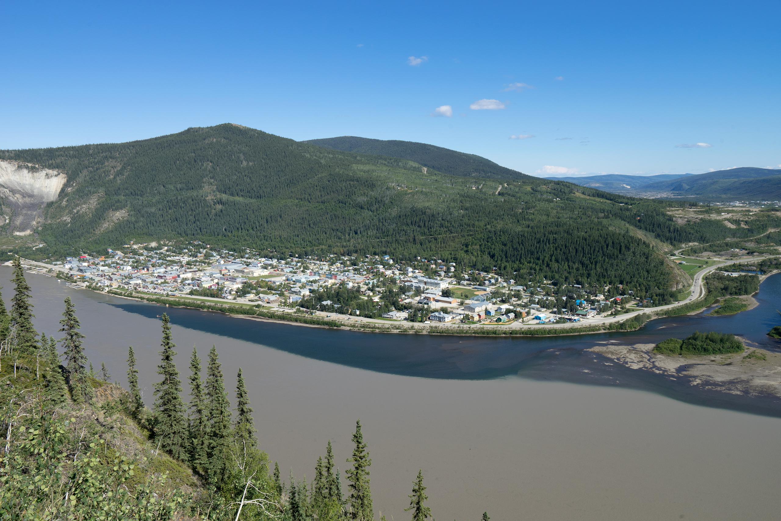 Dawson City and the confluence of the Klondike River (dark, clean) and Yukon River (light, muddy)   Photo: Matthias Ries