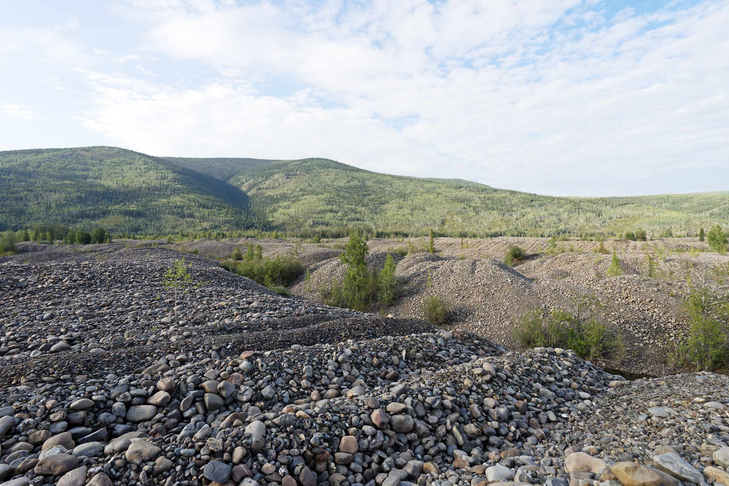 Landscape transforming (destruction) after dredging for gold | Photo: Matthias Ries